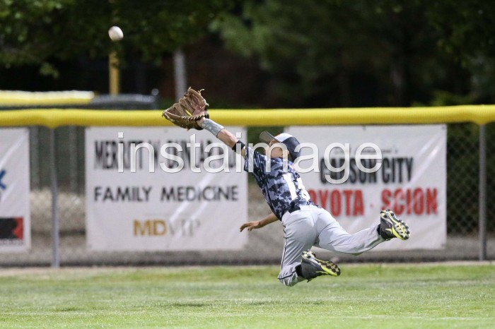 Carson Valley Little League 11 year old Right Fielder dives for a fly ball to right center during their game against Washoe Little League in tonight's opening game of the 2014 Nevada District 1 Little League Tournament at Governor's Field in Carson City, NV